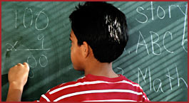 Boy at chalkboard